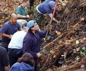 In this Nov. 12, 2003 file photo, members of the Green River task force comb a hillside in an unincorporated area near Kent, Wash.
