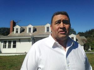Former NFL offensive lineman Brian Holloway stands in front of his rural vacation home Wednesday, Sept. 18, 2013, in Stephentown, NY.
