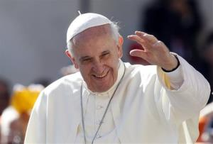 Pope Francis waves to faithful as he arrives for his weekly general audience in St. Peter's Square at the Vatican, Wednesday, Sept. 18, 2013.