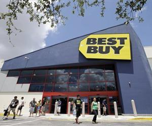 In this Monday, Aug. 19, 2013 photo, shoppers walk toward the parking lot at a Best Buy store in Hialeah, Fla.