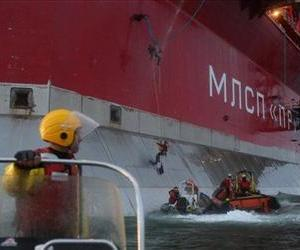 Five Greenpeace activists attempt to climb the Prirazlomnaya, an oil platform operated by Russian state-owned energy giant Gazprom, in Russia's Pechora Sea, Sept. 18, 2013.