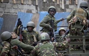 Trucks of soldiers from the Kenya Defense Forces arrive after dawn outside the Westgate Mall in Nairobi, Kenya Sunday, Sept. 22, 2013. Islamic extremist gunmen lobbed grenades and fired assault rifles inside Nairobi's top mall Saturday, killing dozens and wounding over a hundred in the attack. Early Sunday morning, 12...