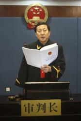 Chief judge Wang Xuguang reads the verdict in Bo Xilai's trial in Jinan, in eastern China's Shandong province, Sunday, Sept. 22, 2013.