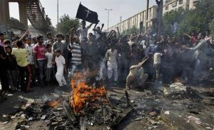 Pakistani Christians chant slogans as they burn materials during a protest against a suicide attack on a church, Sunday, Sept. 22, 2013 in Karachi, Pakistan. A suicide bomb attack on a historic church in northwestern Pakistan killed scores of people Sunday, officials said, in one of the worst assaults on...