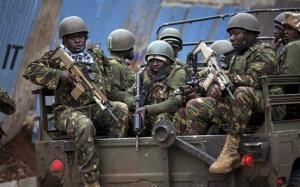 Trucks of soldiers from the Kenya Defense Forces arrive after dawn outside the Westgate Mall.