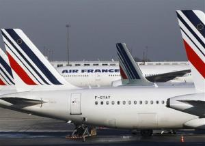 Air France planes are parked on the tarmac at Paris Charles de Gaulle airport.