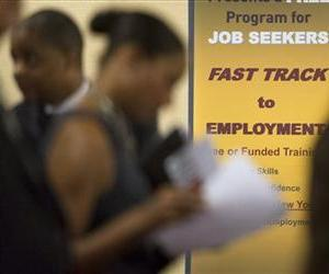 In this Thursday, May 30, 2013, photo, job seekers line up to talk to recruiters during a job fair held in Atlanta.