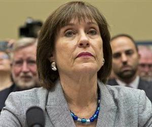 In this May 22, 2013, photo, Lois Lerner listens on Capitol Hill.