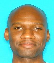 This image released by the FBI shows a 2011 photo of Aaron Alexis.