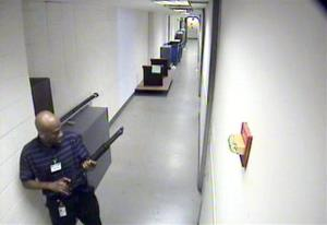 This image from video provided by the FBI shows Aaron Alexis moving through a Navy Yard building.