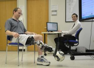Zac Vawter kicks a soccer ball with an experimental bionic leg at the Rehabilitation Institute of Chicago, Thursday, Oct. 25, 2012 in Chicago.