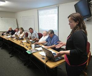 In this July 27, 2010 file photo, Darcy Locken, right, the Modoc County Auditor, outlines the counties financial problems during a County Board of Supervisors meeting in Alturas, Calif.