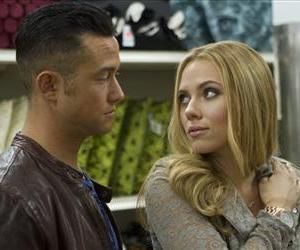 This film image released by Relativity Media shows Joseph Gordon-Levitt, left, and Scarlett Johansson in a scene from Don Jon.