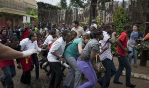 Civilians who had been hiding inside the mall flee during the gun battle on Sept. 21.