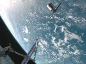 The Cygnus spacecraft is shown at the 30-meter hold point from the International Space Station, Sunday, Sept. 29, 2013, high above the Atlantic Ocean.