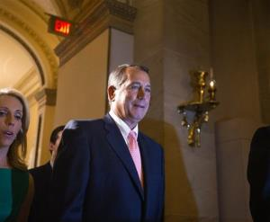 Speaker of the House John Boehner, R-Ohio, returns to his office after a procedural vote on the House floor, at the Capitol in Washington, Monday, Sept. 30, 2013