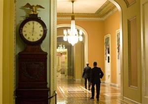 The Ohio Clock outside the Senate Chamber on Capitol Hill shows the time of 12:01 a.m. on Tuesday, Oct. 1, 2013 in Washington.
