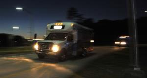 Shuttles used to move people out of Jacksonville International Airport drive by in Jacksonville, Fla. The airport was evacuated after authorities found two suspicious packages.
