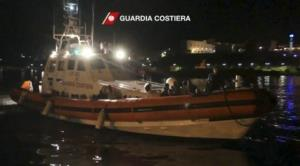 An Italian Coast Guard vessel transporting survivors of a ship that caught fire and sank off the Sicilian island of Lampedusa, arrives at Lampedusa, Italy, Thursday, Oct. 3, 2013.