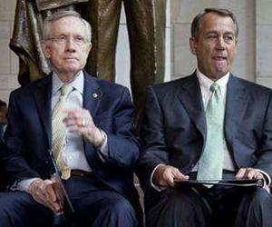 Harry Reid and John Boehner sit next to each other during a ceremony on Capitol Hill in this June file photo.