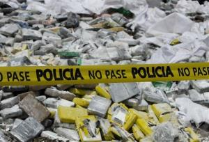 In this June 21, 2013 file photo, yellow police crime tape stretches across packages of seized narcotics at a drug burning operation on the outskirts of Panama City.