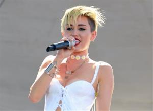 In this Sept. 21, 2013 file photo, Miley Cyrus performs at IHeartRadio Music Village in Las Vegas, Nev.