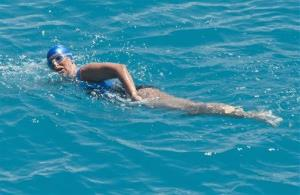 Diana Nyad, positioned about two miles off Key West, Fla., swims towards the completion of her 111-mile trek from Cuba to the Florida Keys.