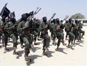 Hundreds of newly trained al-Shabab fighters perform military exercises in in Somalia.