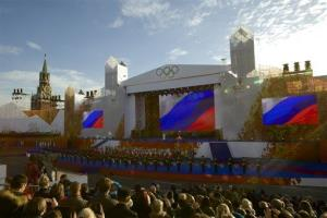 A cauldron with Olympic flame, on stage center, at Moscow's Red Square.