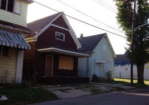These homes on Deshler Street in Buffalo, NY are among five houses on the street that were owned by Theresa Anderson and used in her drug trafficking business.