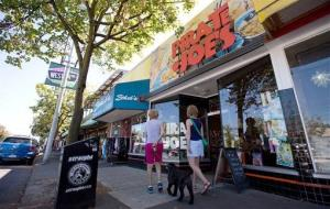 Pedestrians pause to look in the Pirate Joe's store in Vancouver, Canada.