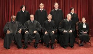 In this Oct. 8, 2010, file photo members of the U.S. Supreme Court. Seated from left are: Clarence Thomas, Antonin Scalia, John Roberts, Anthony M. Kennedy, and Ruth Bader Ginsburg. Standing, from left are: Sonia Sotomayor, Stephen Breyer, Samuel Alito Jr., and Elena Kagan.