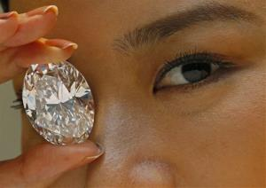 In this Thursday, Sept. 19, 2013 file photo, a 118.28-carat white diamond is displayed at Sotheby's. The diamond the size of a small egg sold for $27.3 million dollars at a Hong Kong auction.