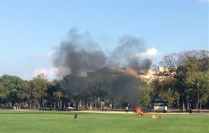 People run to a man who set himself on fire on the National Mall in Washington last Friday.