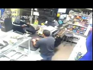 The clerk pulled out the machete from under the counter after the robber demanded cash.