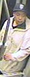 This image taken from a surveillance video and provided by the San Francisco Police Department shows suspect Nikhom Thephakaysone on a MUNI train in San Francisco.