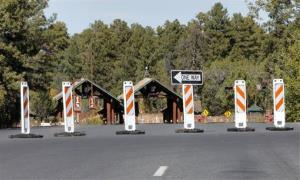 The Grand Canyon National Park entrance is blocked off Tuesday.