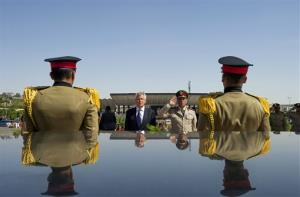 In this Wednesday, April 24, 2013, file photo, US Secretary of Defense Chuck Hagel stands with an Egyptian army official before laying a wreath at the tomb of late President Anwar al-Sadat in Cairo.