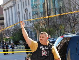 An Ohio County Sherriff Department deputy secures an area in front of the Federal Buildng in Wheeling, West Virginia Wedneday, Oct. 9, 2013, following a shooting outside the courthouse.
