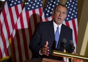 House Speaker John Boehner of Ohio gestures while speaking outside his office on Capitol Hill in Washington, Tuesday, Oct. 8, 2013.