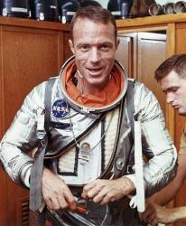 In this August 1962 file photo, astronaut Scott Carpenter has his space suit adjusted by a technician at Cape Canaveral.