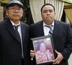 Jeffrey Uno, right, and his father, Peter Uno, the son and husband of Noriko Uno, seen in framed photo.