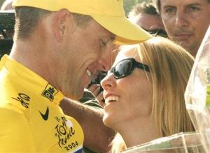This 2004 file photo shows Lance Armstrong kissing Sheryl Crow as he celebrates his sixth straight Tour de France cycling race victory in Paris.