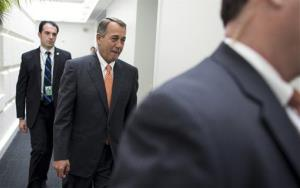 Speaker of the House John Boehner leaves a House Republican conference meeting on Capitol Hill Oct. 12.
