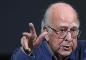Britain's Professor Peter Higgs gestures, during a press conference.