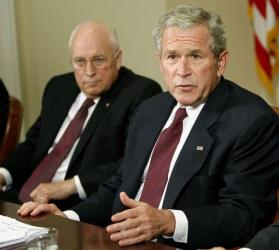 Vice President Dick Cheney looks on as President Bush speaks to reporters in the Roosevelt Room of the White House in Washington, Monday, Sept. 15, 2008.