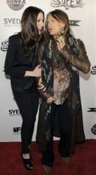 Liv Tyler, left, a cast member in Super, and her father Steven Tyler arrive together at the premiere of the film in Los Angeles, Monday, March 21, 2011.