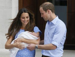 Britain's Prince William, right, and Kate, Duchess of Cambridge hold the Prince of Cambridge, in this July 23, 2013, photo as they pose outside St. Mary's Hospital's exclusive Lindo Wing in London.