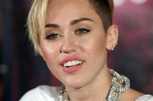 Recording artist Miley Cyrus attends an album release signing event, on Tuesday, Oct. 8, 2013, at Planet Hollywood in New York.