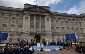 The queen, bottom center, Duke of Edinburgh, right, and Prince Imran of Malaysia, left, attend the 2014 Glasgow Commonwealth Games Baton relay launch ceremony at the Buckingham Palace, Oct. 9, 2013.